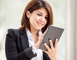Woman checking out website on tablet